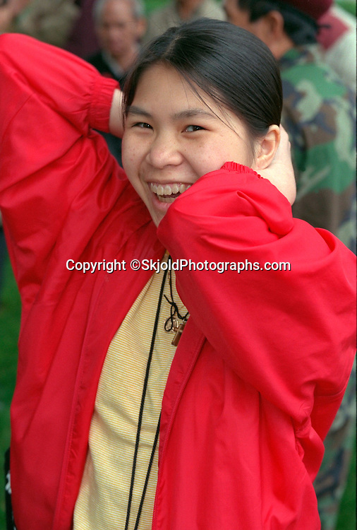 Asian woman age 27 smiling at the Vietnam Wall on Memorial Day. St Paul Minnesota USA
