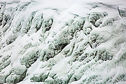 Spray from Gullfoss waterfall in Iceland causes unusual ice sculptures to form