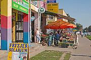 Neighborhood market filled with grocery butcher restaurants and shops. Lutomierska Street Balucki District Lodz Central Poland