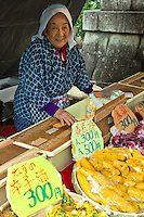 """Pickle Lady at Kitano Tenmangu Shrine Market - On the 25th of every month, Kitano Tenmangu Shrine  hosts a flea market. Together with the similar market at Toji Temple, they inspired the Kyoto proverb, """"Fair weather at Toji Market means rainy weather at Tenjin market,"""" referring to Kyoto's fickle weather."""