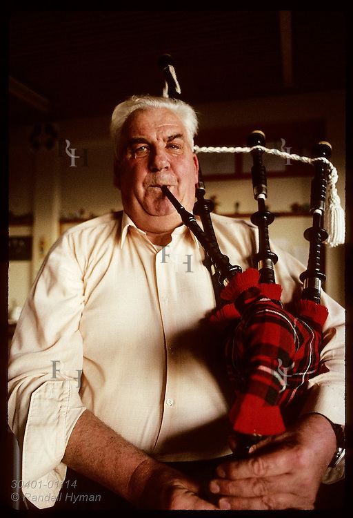 Jim Anderson, Blackwatcher who played at JFK's funeral, plays a tune on his bagpipes; Buckhaven. Scotland