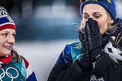 February 13, 2018 - Stockholm, Sweden - OS 2018 i Pyeongchang. Sprint, damer. Stina Nilsson, längdskidÃ¥kare Sverige, vann och Majken Kaspersen Falla, Norge, kom tvÃ¥a. tävling action landslaget guld  glad grÃ¥ter (Credit Image: © Orre Pontus/Aftonbladet/IBL via ZUMA Wire)