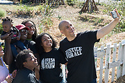 Democratic presidential hopeful Senator Cory Booker poses for a selfie with volunteers during a visit to Fresh Future Farm April 27, 2019 in North Charleston, South Carolina. Booker spent his 50th birthday helping out at the urban farm as part of his Justice For All tour.