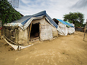 07 NOVEMBER 2014 - SITTWE, RAKHINE, MYANMAR: Tents in an IDP camp for the Rohingya Muslims. After sectarian violence devastated Rohingya communities and left hundreds of Rohingya dead in 2012, the government of Myanmar forced more than 140,000 Rohingya Muslims who used to live in and around Sittwe, Myanmar, into squalid Internal Displaced Persons camps. The government says the Rohingya are not Burmese citizens, that they are illegal immigrants from Bangladesh. The Bangladesh government says the Rohingya are Burmese and the Rohingya insist that they have lived in Burma for generations. The camps are about 20 minutes from Sittwe but the Rohingya who live in the camps are not allowed to leave without government permission. They are not allowed to work outside the camps, they are not allowed to go to Sittwe to use the hospital, go to school or do business. The camps have no electricity. Water is delivered through community wells. There are small schools funded by NOGs in the camps and a few private clinics but medical care is costly and not reliable.   PHOTO BY JACK KURTZ