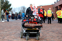 A dog wearing sunglasses and a Liverpool shirt outside the ground before the Premier League match at Anfield, Liverpool.