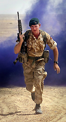 FIle IMAGE © Licensed to London News Pictures. 16/12/2016.Sergeant Alexander Blackman takes part in Operation Safe Sword 2 in the Omani desert in this archive picture taken on October 31st 2001. A campaign has been launched by Sgt Blackman's family to have his sentence for killing a Talliban insurgent in Afghanistan in 2011 reviewed. Sgt Blackman was convicted of murder at a court martial in 2013 Photo credit: Peter Macdiarmid/LNP