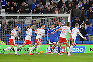 Barnsley's Sam Winnall (9) celebrates after he scores his teams second goal with team mates. EFL Skybet championship match, Cardiff city v Barnsley at the Cardiff city stadium in Cardiff, South Wales on Saturday 17th December 2016.<br /> pic by Carl Robertson, Andrew Orchard sports photography.