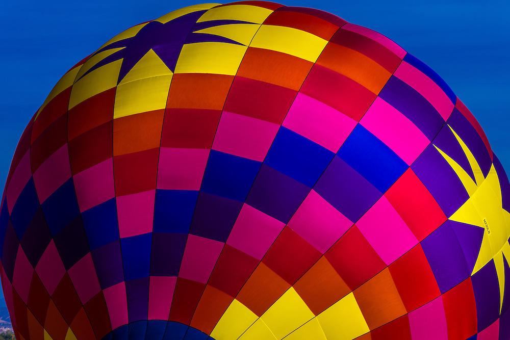 A colorful hot air balloon envelope (balloon is named Sunglow), Albuquerque International Balloon Fiesta, Albuquerque, New Mexico USA.