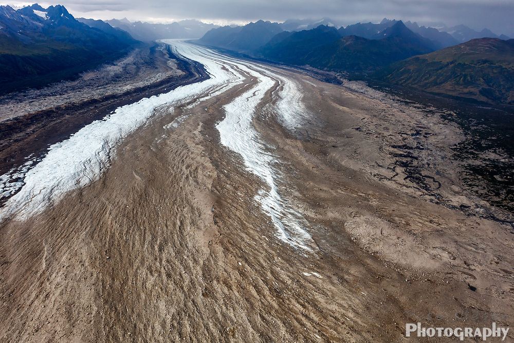 Aerial view of glacial morain at the foot of long flowing glacier