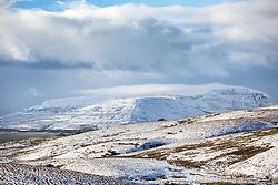 © Licensed to London News Pictures. 10/11/2016. Ingleton UK. Picture shows the snow covered Whernside mountain in the Yorkshire Dales. Photo credit: Andrew McCaren/LNP