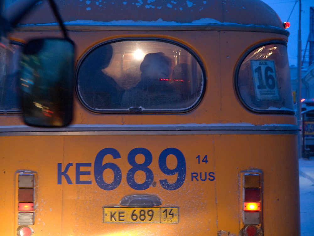 People sitting in a Yakutsk bus. Yakutsk is a city in the Russian Far East, located about 4 degrees (450 km) below the Arctic Circle. It is the capital of the Sakha (Yakutia) Republic (formerly the Yakut Autonomous Soviet Socialist Republic), Russia and a major port on the Lena River. Yakutsk is one of the coldest cities on earth, with winter temperatures averaging -40.9 degrees Celsius.