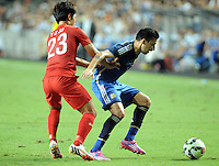 Santiago Vergini of Argentina, right, challenges Ju Yingzhi of Hong Kong during a friendly football match in Hong Kong, China, 14 October 2014.<br /> <br /> Lionel Messi needed just six minutes to make his mark in Argentina's 7-0 rout of Hong Kong in a friendly at Hong Kong Stadium on Tuesday (14 October 2014). The Barcelona star Messi scored twice after going on as a substitute for the last 30 minutes of the game to celebrate the 100th anniversary of the Hong Kong Football Association. Napoli striker Gonzalo Higuain and Benfica's Nicolas Gaitan also scored two goals each after Sevilla's Ever Banega had opened scoring in the 19th minute.