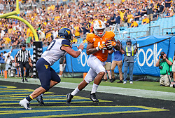 Sep 1, 2018; Charlotte, NC, USA; Tennessee Volunteers tight end Dominick Wood-Anderson (4) catches a touchdown pass during the first quarter against the West Virginia Mountaineers at Bank of America Stadium. Mandatory Credit: Ben Queen-USA TODAY Sports
