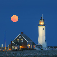 New England photography of Scituate Lighthouse with Worm full moon rising. This beautiful Massachusetts lighthouse is located on Cedar Point in Scituate Massachusetts.<br /> <br /> Picturesque Old Scituate Lighthouse with full moon rise photography pictures are available as museum quality photography prints, canvas prints, acrylic prints, wood prints or metal prints. Fine art prints may be framed and matted to the individual liking and interior design decorating needs:<br /> <br /> https://juergen-roth.pixels.com/featured/old-scituate-lighthouse-with-full-moon-juergen-roth.html<br /> <br /> Good light and happy photo making!<br /> <br /> My best,<br /> <br /> Juergen