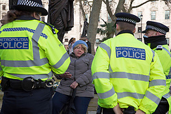 © Licensed to London News Pictures.06/01/2021, London, UK. A group of anti-lockdown protesters Stand up X, gathered at Parliament Square as the second day of the 3rd national Covid-19 lockdown continues. Photo credit: Marcin Nowak/LNP