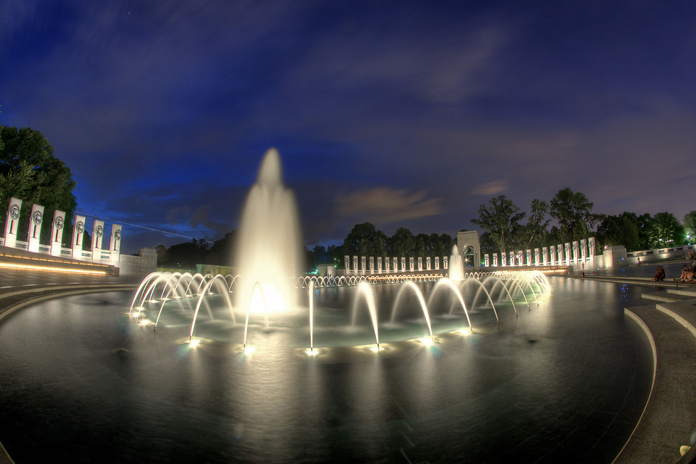 Water rushes around the National WWII Memorial in Washington, DC,  on Friday, August 15, 2014. Copyright 2014 Jason Barnette
