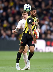 Watford's Andre Gray (front) and Manchester United's Victor Lindelof battle for the ball
