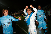 FOOTBALL - FRENCH CHAMPIONSHIP 2009/2010 - L1 - OLYMPIQUE MARSEILLE v STADE RENNAIS - 5/05/2010 - PHOTO PHILIPPE LAURENSON / DPPI - CELEBRATION GABRIEL HEINZE / ANDRADE / STEVE MANDANDA (OM) AFTER WINNING THE FRENCH'S LIGUE 1 CHAMPIONSHIP