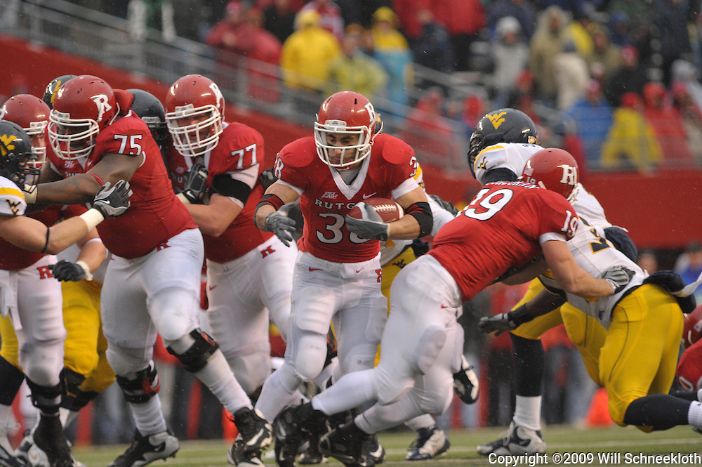 Dec 5, 2009; Piscataway, NJ, USA; Rutgers running back Joe Martinek (38) runs up the middle during second half NCAA Big East college football action in West Virginia's 24-21 victory over Rutgers at Rutgers Stadium.