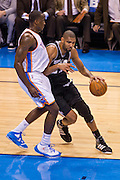 June 2, 2012; Oklahoma City, OK, USA; Oklahoma City Thunder center Kendrick Perkins (5) applies pressure as San Antonio Spurs.forward Tim Duncan (21) dribbles during a playoff game  at Chesapeake Energy Arena.  Thunder defeated the Spurs 109-103 Mandatory Credit: Beth Hall-US PRESSWIRE