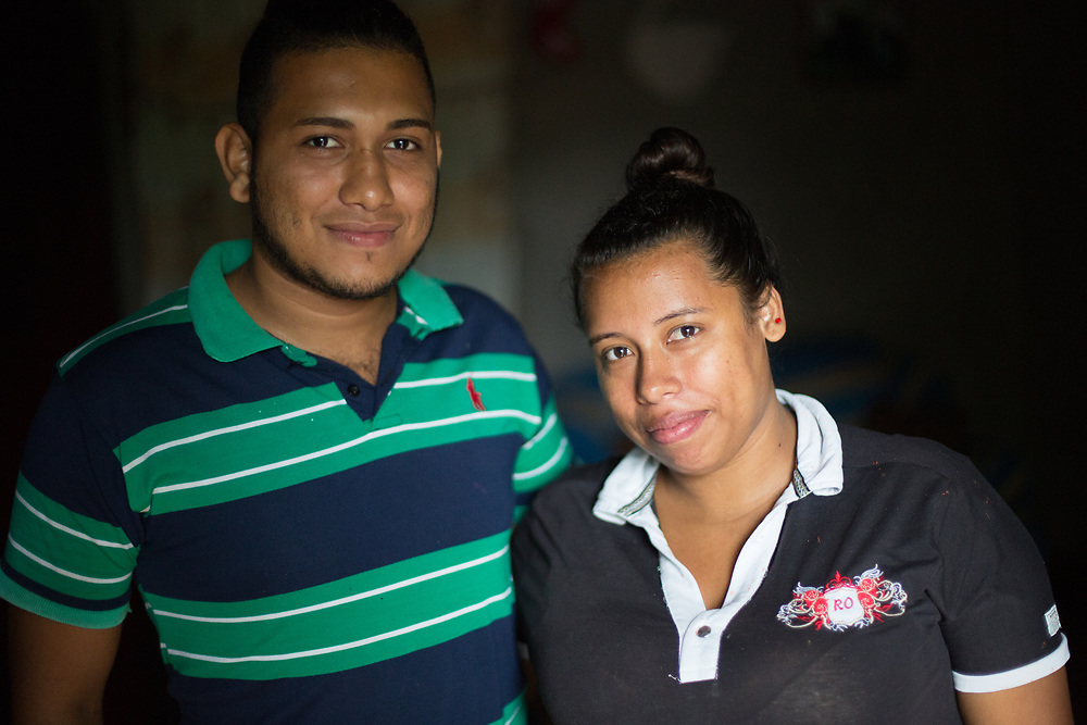 Yelin Javier Matute Ramos, 22. (with Ruth Abigael, his girlfriend)<br /> <br /> My father went with a smuggler to the US, but they had a fight.  My cousin was with them, he told us the story afterwards. They were in a cabin, but they left my dad outside. The smuggler tried to kill him by beating him, but he wouldn't die, so he found a machete, cut his hand off, and killed him. Then he tied him to the back of a car and dragged his body around on the dirt road and dumped his body on the railway, so that they'd think he was killed by the train. His wife had to identify him, he was unrecognisable. They sent his body back. <br /> <br /> Despite that, I decided to try my own luck and migrate.<br /> <br /> My mother is in the US, I haven't seen her for 12 years. <br /> <br /> I decided to go last year. <br /> <br /> A cartel stopped the lorry we were travelling in, they got us all out of the trailer. They told us all to get out all our money, or that they'd kill us. They put all the women separately.<br /> <br /> They killed the driver of the lorry, and his assistant. They asked the lorry driver how many people he was carrying, he said 40, they told him to count us, there were 125 of us. They cut four fingers off his hand, one by one, and then they put a knife into his throat. I didn't want to see it, but they did it in front of us. Then they did the same to his assistant, they cut off four fingers and pushed a knife into his throat. <br /> <br /> They left us there on the side of the road. We were picked up by Mexican migration and seven days later we were back in Honduras. Everyone I went with went straight back, but I decided to stay. They've all got through to the US.<br /> <br /> We got a bus fare to get back to Olancho, we got back with nothing.<br /> Someone told me about the LWF programme and I decided to learn welding, I have those skills now, for life, no one can take that from me. And I'm working in buildings, making furniture, and I have my own equipment.<br />