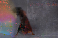 """Dark blurred female figure dancing into rainbow light and flames.  """"One does not become enlightened by imagining figures of light, but by making the darkness conscious."""" -Carl Jung"""