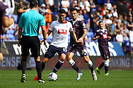 Gary Madine of Bolton Wanderers passes under pressure from George Thorne of Derby County. Skybet football league championship match, Bolton Wanderers v Derby County at the Macron stadium in Bolton, Lancs on Saturday 8th August 2015.<br /> pic by Chris Stading, Andrew Orchard sports photography.