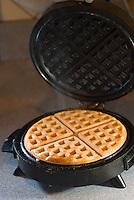 Waffle being made on waffle iron