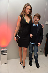 ELIZABETH HURLEY and her son DAMIAN HURLEY at a pre party for the English National Ballet's Christmas performance of The Nutcracker was held at the St.Martin's Lane Hotel, St.Martin's Lane, London on 12th December 2013.