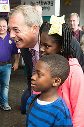 © Licensed to London News Pictures. 02/06/2017. London, UK. <br /> Former UKIP leader Nigel Farage poses for a photo with local children in Dagenham Heathway during a general election campaign. Photo credit: Ray Tang/LNP
