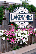 Pink and white petunias in flower box at yacht club entry.  Minnetonka Minnesota USA