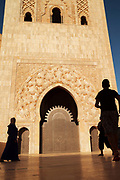 Low angle view of people walking in front of Hassan II Mosque in Casablanca, Morocco