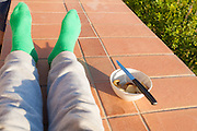 Legs of a child, green socks
