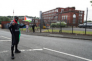 """Oldham, United Kingdom, June 21, 2021: People wearing face protective masks are gathered outside """"Cairo House"""" in Oldham on Monday, June 21, 2021 - following the arrest of Palestine Action activists after they scaled the roof Monday morning. This is the ongoing protest forms of the human rights activists group in Britain targeting an Israeli owned weapons manufacturer Elbit Systems. Activists argue that arms being manufactured in the facility are being used in indiscriminate attacks against the Gaza Strip. (VX Photo/ Vudi Xhymshiti)"""