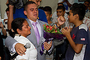 """Four years after having lost contact, Olga Marina Hernández, from Progreso, Honduras, reunites in Escobedo, outskirts of Monterrey, with her son  Gabriel Salmerón Hernández. Gabriel tried to get to the U.S. after being deported once, but he never made it. Currently, he is part of a rehabilitation center called """"Cristo Vive"""" in this location. (Photo: Promete Lucero)"""