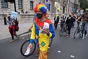 Clown protester at Extinction Rebellion demonstration on 3rd September 2020 in London, United Kingdom. With government resitting after summer recess, the climate action group has organised two weeks of events, protest and disruption across the capital. Extinction Rebellion is a climate change group started in 2018 and has gained a huge following of people committed to peaceful protests. These protests are highlighting that the government is not doing enough to avoid catastrophic climate change and to demand the government take radical action to save the planet.