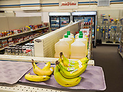 """25 FEBRUARY 2020 - BUTTERFIELD, MINNESOTA: Bananas in the True Value Hardware Store in Butterfield, MN, a farming community of about 500 people 130 miles southwest of the Twin Cities. The town has been a """"food desert"""" for 10 years after its only grocery store closed in 2010. Barb Mathistad Warner and Mark Warner purchased the True Value store in Butterfield in December, 2018 and started selling groceries in the store in May, 2019. For residents of Butterfield going to a grocery store meant driving 10 miles to St. James, MN, or 20 miles to Windom, MN, the two nearest communities with grocery stores. The USDA defines rural food deserts as having at least 500 people in a census tract living 10 miles from a large grocery store or supermarket. There is a convenience store in Butterfield, but it sells mostly heavily processed, unhealthy snack foods that are high in fat, sugar, and salt.    PHOTO BY JACK KURTZ"""