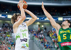 Jaka Klobucar of Slovenia vs Raul Neto of Brasil during friendly basketball match between National Teams of Slovenia and Brasil at Day 2 of Telemach Tournament on August 22, 2014 in Arena Stozice, Ljubljana, Slovenia. Photo by Vid Ponikvar / Sportida