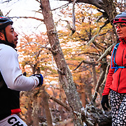 Heather Goodrich speaking with Mauricio Quinteros Ozellana inside of the lenga or beech tree forest of Patagonia at sunrise over the Paine Massive and Los Torres.