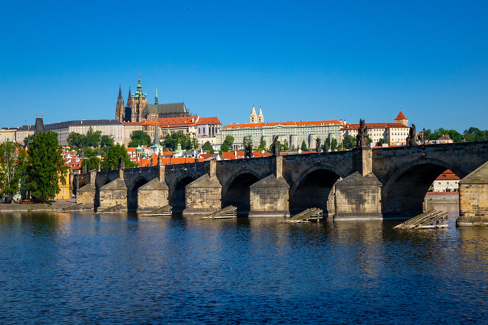Distant view of St. Vitus's cathedral and Prague Castle as seen from across the Vltava River with the Charles Bridge in the foreground, Czech Republic