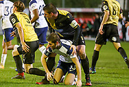 Tottenham Hotspur defender Ben Davies (33) on the ground with Marine forward Niall Cummins (9) during the The FA Cup match between Marine and Tottenham Hotspur at Marine Travel Arena, Great Crosby, United Kingdom on 10 January 2021.