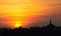 ©Licensed to London News Pictures 09/04/2020  <br /> Orpington, UK. An Easter sunset tonight with the steeple and cross of St Barnabas church in Orpington, South East London. Photo credit:Grant Falvey/LNP