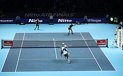Mike and Bob Bryan in action against during their doubles match against Bruno Soares (top left) and Jamie Murray during day two of the NITTO ATP World Tour Finals at the O2 Arena, London.
