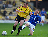 Photo: Daniel Hambury.<br />Watford v Leicester City. Coca Cola Championship.<br />15/10/2005.<br />Watford's Malky Mackay and Leicester's Iain Hume battle for the ball.