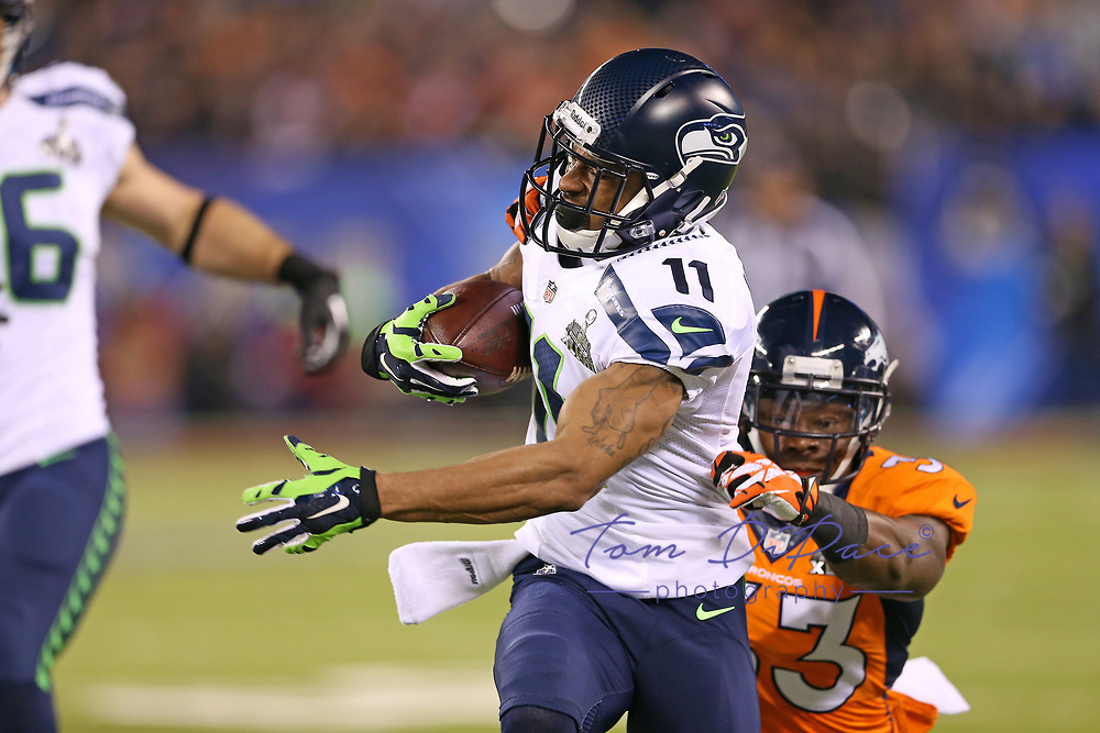 Seattle Seahawks Percy Harvin (11) runs with the ball during the second half of the NFL Super Bowl XLVIII football game against the Denver Broncos, Sunday, Feb. 2, 2014, in East Rutherford, N.J<br /> <br /> Photo By Tom DiPace