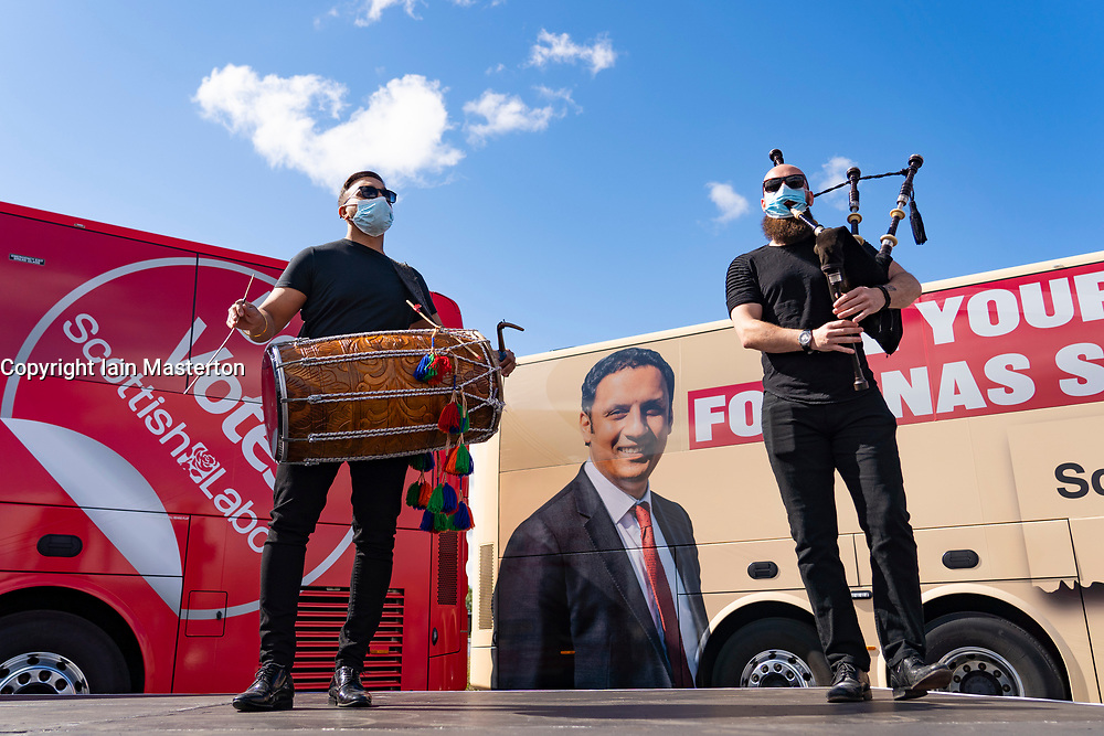 Glasgow, Scotland, UK. 5 May 2021. Scottish Labour Leader Anas Sarwar and former Prime Minister Gordon Brown appear at an eve of polls drive-in campaign rally in Glasgow today. Musicians entertain the rally before the speeches.   Iain Masterton/Alamy Live News