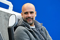 BRIGHTON, ENGLAND - MAY 12:   Manchester City manager Pep Guardiola sits in the dugout ahead of the Premier League match between Brighton & Hove Albion and Manchester City at American Express Community Stadium on May 12, 2019 in Brighton, United Kingdom. (MB Media)