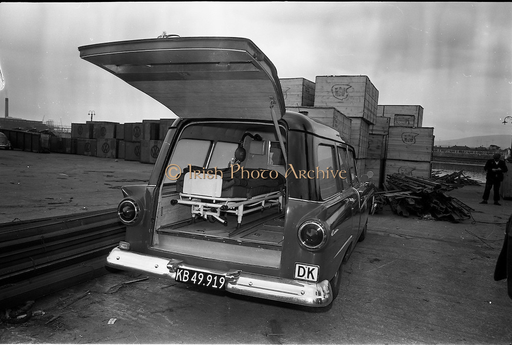 """25/06/1963<br /> 06/25/1963<br /> 25 June 1963<br /> Ford station wagon Ambulance being unloaded from the ship the """"City of Cork"""" at the North Wall, Dublin port. View of the interior of the ambulance"""