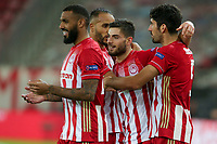 PIRAEUS, GREECE - OCTOBER 21: Players of Olympiacos FC celebrate a goal that was finally cancelled during the UEFA Champions League Group C stage match between Olympiacos FC and Olympique de Marseille at Karaiskakis Stadium on October 21, 2020 in Piraeus, Greece. (Photo by MB Media)