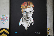 David Bowie street art mural in central Birmingham, United Kingdom. David Bowie, was an English singer, songwriter and actor. He was a figure in popular music for over five decades, becoming acclaimed by critics and other musicians for his innovative work.